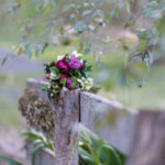 MACEDON RANGES HOTEL AND SPA Flowers on fence blurred